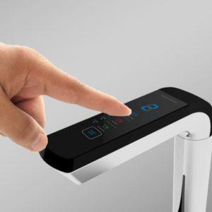 finger touching ionplus faucet control